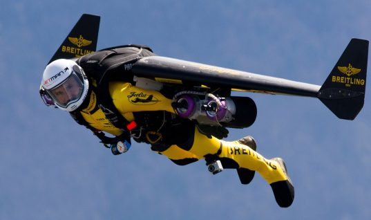 Watch These Men With Jetpacks Fly Next to an Airplane