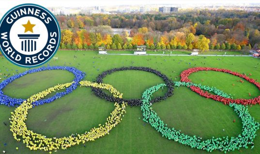 Here Is What 6,211 People Arranged Into Olympic Rings Looks Like
